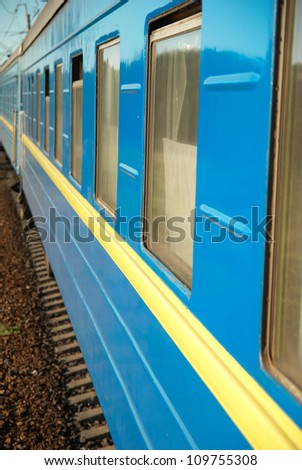 Motion train and blue wagon. Urban transportation - stock photo