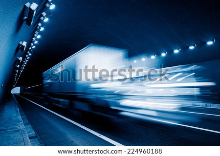 motion truck go through the tunnel. - stock photo