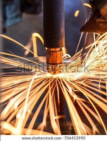 Motion Welding robots in a car factory with sparks, manufacturing, industry, factory