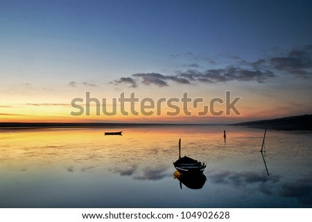Motionless Fleet;  A beautiful calm sunset at the chesil fleet in Dorset. - stock photo