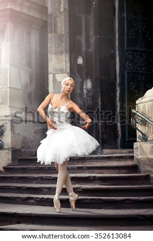 Motions of grace. Soft focus shot of a young female ballet dancer practicing on the stairway of an old building  - stock photo