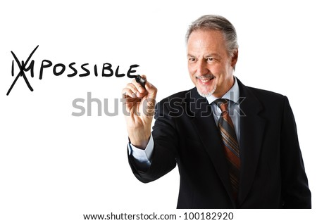 Motivation concept. Businessman changing the word impossible into possible - stock photo