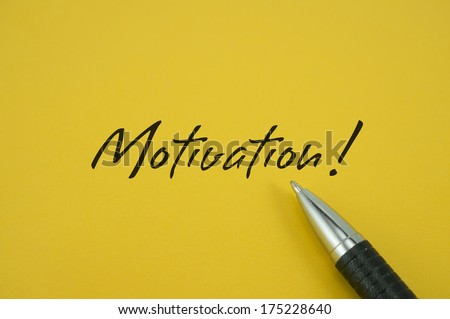 Motivation! note with pen on yellow background