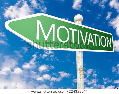 Motivation - street sign illustration in front of blue sky with clouds. - stock photo