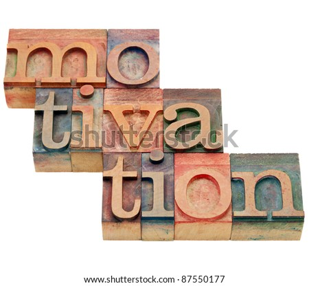 motivation word - isolated abstract in vintage wood letterpress printing blocks