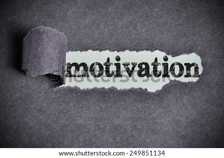 motivation  word under torn black sugar paper  - stock photo