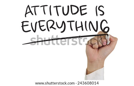 Motivational concept image of a hand holding marker and write Attitude is Everything isolated on white - stock photo