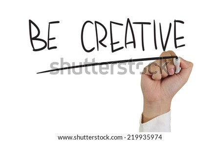 Motivational concept image of a hand holding marker and write be creative isolated on white - stock photo