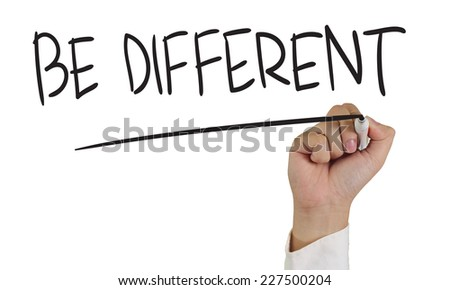 Motivational concept image of a hand holding marker and write Be Different isolated on white - stock photo