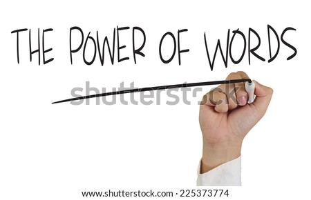 Motivational concept image of a hand holding marker and write The power of words isolated on white - stock photo