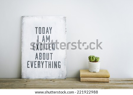 motivational inspirational poster quote TODAY I'M EXCITED ABOUT EVERYTHING on the white wall. American or Scandinavian style room interior.  - stock photo