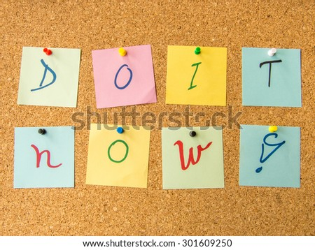 motivational message do it now with exclamation mark written on post it notes - stock photo