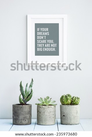 """MOTIVATIONAL POSTER WITH SUCCULENTS IN CONCRETE POTS """"IF YOUR DREAMS DON'T SCARE YOU, THEY ARE NOT BIG ENOUGH"""" - stock photo"""