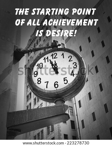 Motivational quote about live by an unknown author, on a downtown street clock at a few minutes before twelve - stock photo