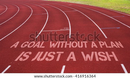 Motivational quote written on running track : A Goal Without A Plan is Just a Wish - stock photo