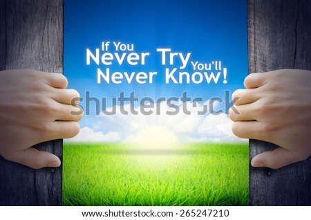"""Motivational quotes """"If you never try you will never know"""" . Hands opening a wooden door then found a texts floating among new world as green grass field, Blue sky and the Sunrise. - stock photo"""