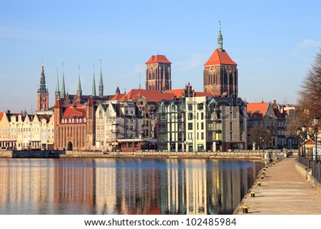Motlawa river with city skyline in the background of Gdansk, Poland.
