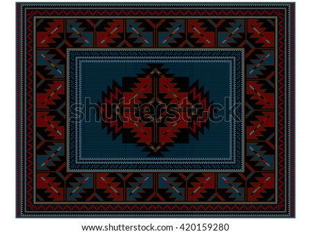Motley ethnic carpet with vintage ornament and blue in the middle  - stock photo