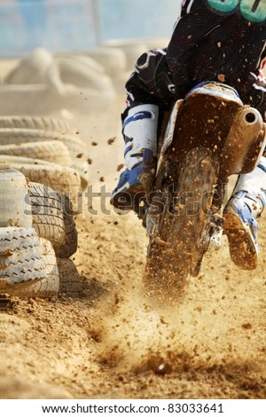 motocross bike increase speed in track - stock photo