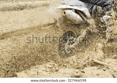 Motocross in muddy track - stock photo