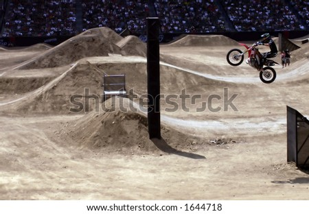 Motocross Jump with crowd in backgorund. - stock photo