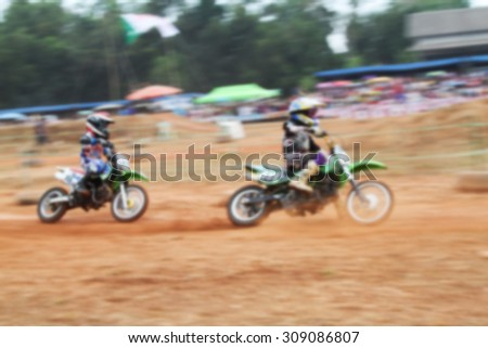 Motocross race blurry for background.