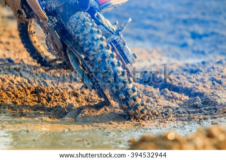 Motocross racer accelerating in dirt track, Details of debris in a motocross race and Picture blur - stock photo