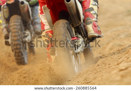 motocross racer accelerating speed in track - stock photo