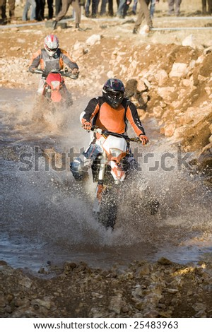 motocross racer riding motorcycle - stock photo