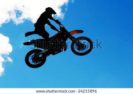 Motocross rider doing some daring tricks in a high jump