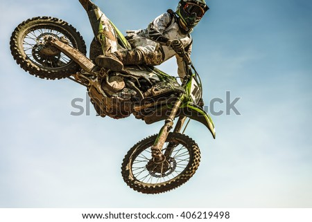 Motocross rider in the air - stock photo