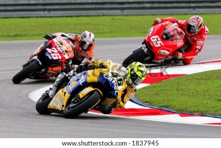 MotoGP rider Valentino Rossi (front), Dani Pedrosa (second) and Loris Capirossi - stock photo