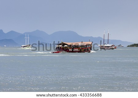 Motor boat on Ilha Grande Bay - stock photo
