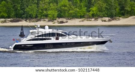 motor boat on the lake - stock photo