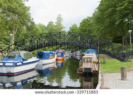 Motor boats in a canal at Silkeborg, Denmark. Copy space
