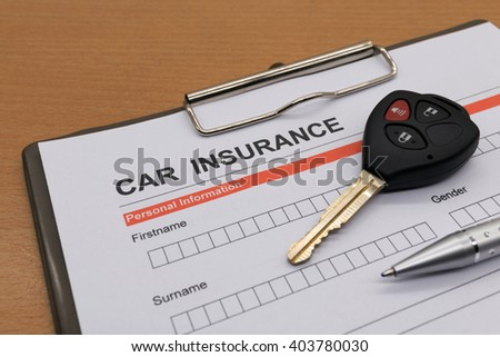 motor insurance with car key and pen