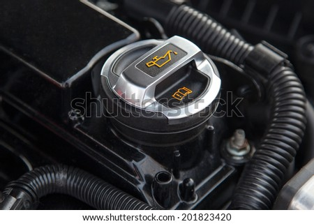 Motor oil cap under the hood of a car - stock photo