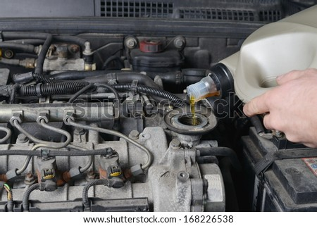 Motor oil, car engine close up  - stock photo