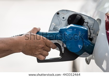 Motor oil, car engine close up - stock photo