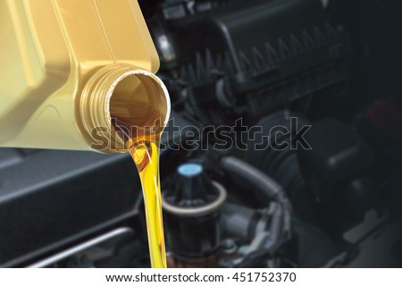 Motor oil pouring, Pouring oil lubricant motor car from bottle