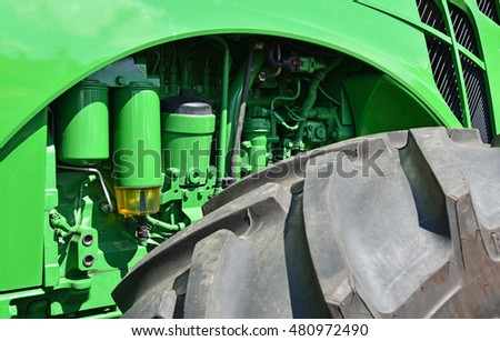Motor part of a tractor and tire