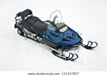 motor sled at white snow transport drive