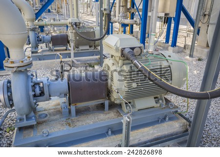 Motor with pump in industrial plant - stock photo
