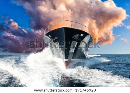 motor yacht prow at sunset - stock photo