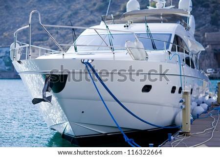 Motor yachts over harbor pier, Balaklava, Ukraine - stock photo