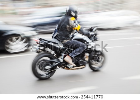 motorbike in city traffic in motion blur - stock photo