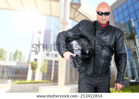 Motorbike rider with helmet and sunglasses - stock photo