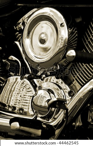 Motorbike's chromed engine (sepia) - stock photo