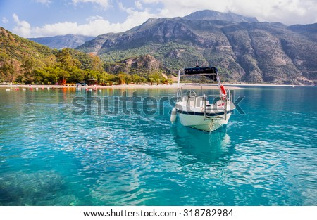 Motorboat against Oludeniz, Oludeniz is one of the most famous beach in Turkey - stock photo