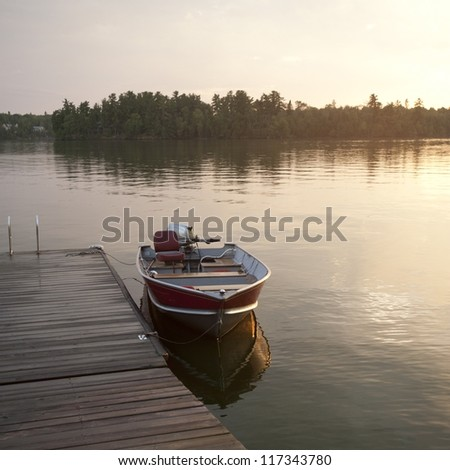 Motorboat at the dock in Lake of the Woods, Ontario - stock photo